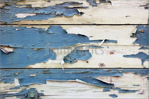 paint peeling on an exterior shed wall material