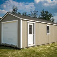 A custom storage shed garage in Georgia with painted wood siding
