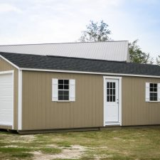 A custom storage shed garage in Georgia with white doors