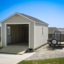 A custom storage shed garage in Georgia with a wooden ramp