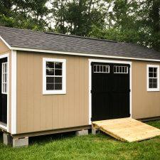 A custom storage shed in Georgia with black doors