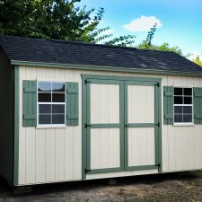 A custom storage shed in Georgia with green trim
