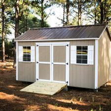 A custom storage shed in Georgia with a brown metal roof