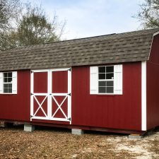 A red custom storage shed with a loft in Georgia