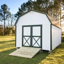 A custom lofted storage shed in Georgia at sunset