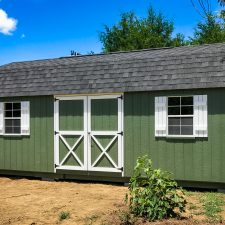 A custom lofted storage shed in Georgia with green painted siding
