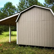 A custom lofted storage shed in Georgia with a lean-to