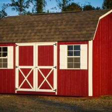 A red custom lofted storage shed in Georgia with white trim