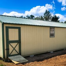 A custom storage shed in Georgia with a green metal roof