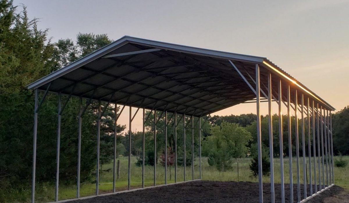 An open-side carport car shed